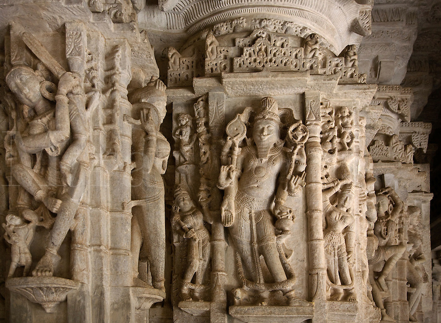 CELESTIAL DEITIES carved from white marble inside the CHAUMUKHA MANDIR TEMPLE at RANAKPUR in the Pali District of RAJASTHAN near Sadri - INDIA