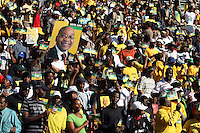 African National Congress (ANC) supporters hold up a poster of Jacob Zuma at the party's final Siyanqoba (victory) rally held at the Ellis Park Stadium in Johannesburg before the 2009 general election.