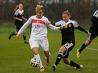 20141126 - TUBIZE , BELGIUM : Turkish Gülbin Hiz (left) pictured being tackled by Belgian Chloe Van Mingeroet (r)  during the Friendly female soccer match between Women under 19 / 21  teams of  Belgium and Turkey .Wednesday 26th November 2014 . PHOTO DAVID CATRY