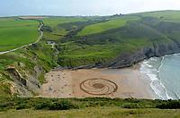 2020 07 07 World renowned sand artist Marc Treanor, Trebarwith Strand, Cornwall, UK.