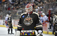HERSHEY, PA - MARCH 16: Hershey Bears goalie Ilya Samsonov (35) looks through the bars of his Washington Capitals goalie mask while wearing a special Autism Awareness Night puzzle pieces jersey during the Bridgeport Sound Tigers vs. the Hershey Bears AHL hockey game March 16, 2019 at the Giant Center in Hershey, PA. (Photo by Randy Litzinger/Icon Sportswire)