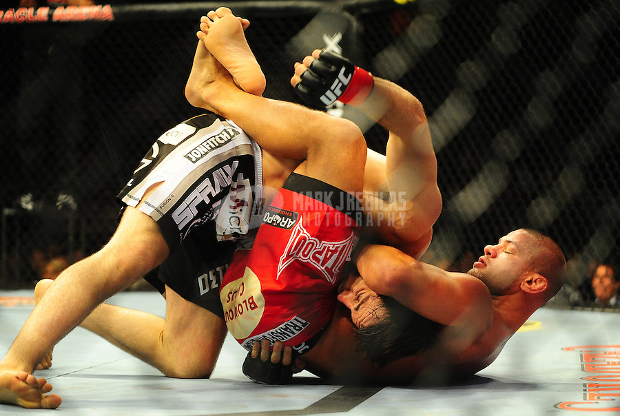 Aug. 7, 2010; Oakland, CA, USA; UFC fighter Thiago Alves (right) against Jon Fitch (left) during the welterweight bout in UFC 117 at the Oracle Arena. Mandatory Credit: Mark J. Rebilas