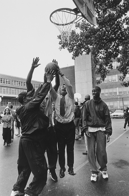 Sen. Jack Reed, D-R.I., playing with H. D. Woodson high school students at Jr. H. B. courts in June 1997. (Photo by Maureen Keating/CQ Roll Call via Getty Images)
