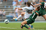 30 September 2012: UNC's Paige Nielsen (24) scores a goal after getting past Miami's Allie Rossi (below) and Ally Andreini (right). The University of North Carolina Tar Heels defeated the University of Miami Hurricanes 6-1 at Fetzer Field in Chapel Hill, North Carolina in a 2012 NCAA Division I Women's Soccer game.