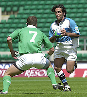 24/05/2002 (Friday).Sport -Rugby Union - London Sevens.Argentina vs Ireland.Martin Gaitan, look's to move past Ireland's John McWeeney.[Mandatory Credit, Peter Spurier/ Intersport Images].