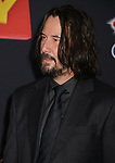"""Keanu Reeves    arrives at the premiere of Disney and Pixar's """"Toy Story 4"""" on June 11, 2019 in Los Angeles, California."""