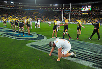 Mitchell Graham sinks to his knees at the final whistle during the Super Rugby semifinal match between the Hurricanes and Chiefs at Westpac Stadium, Wellington, New Zealand on Saturday, 30 July 2016. Photo: Dave Lintott / lintottphoto.co.nz