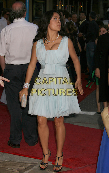 "SALMA HAYEK .""Vicky Cristina Barcelona"" Los Angeles Premiere held at the Mann Village Theatre, Westwood, California, USA, .04 August 2008..full length pale blue dress pearl necklace bracelet black t-bar strappy sandals shoes funny looking back over shoulder.CAP/ADM/MJ.©Michael Jade/Admedia/Capital Pictures"