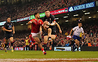 Wales' Steff Evans collects the high ball and goes onto score a try <br /> <br /> Photographer Ian Cook/CameraSport<br /> <br /> Under Armour Series Autumn Internationals - Wales v Tonga - Saturday 17th November 2018 - Principality Stadium - Cardiff<br /> <br /> World Copyright © 2018 CameraSport. All rights reserved. 43 Linden Ave. Countesthorpe. Leicester. England. LE8 5PG - Tel: +44 (0) 116 277 4147 - admin@camerasport.com - www.camerasport.com