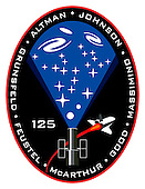 Houston, TX - (FILE) -- This STS-125 crew patch from December, 2007 shows HST along with a representation of its many scientific discoveries. The overall structure and composition of the Universe is shown in blue and filled with planets, stars, and galaxies. The black background is indicative of the mysteries of dark-energy and dark-matter. The new instruments to be installed on HST during this mission, Wide Field Camera-3 and the Cosmic Origins Spectrograph, will make observations to help understand these unseen components which seem to dominate the structure of the Universe. The red border of the patch represents the red-shifted glow of the early Universe, and the limit of the Hubble's view into the cosmos. Upon completion of STS-125, the fifth mission to service HST, the Hubble will provide even deeper and more detailed views of the Universe. Soaring by the telescope is the space shuttle which initially deployed Hubble and has enabled astronauts to continually upgrade the telescope, significantly contributing to the expansion of human knowledge. The STS-125 crew is scheduled to launch Monday, May 11, 2009 at 2:01 p.m. EDT aboard the Space Shuttle Atlantis for a mission to service the Hubble Space Telescope.  The NASA insignia design for shuttle flights is reserved for use by the astronauts and for other official use as the NASA Administrator may authorize. Public availability has been approved only in the form of illustrations by the various news media. When and if there is any change in this policy, which is not anticipated, it will be publicly announced.Credit: NASA via CNP