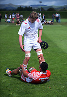 Taine Plumtree helps Heimuli Taufa up after the final whistle in the international rugby match between  New Zealand Schools Barbarians and Tonga Schools at the Sport and Rugby Institute in Palmerston North, New Zealand on Thursday, 28 September 2017. Photo: Dave Lintott / lintottphoto.co.nz