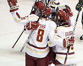 Edwin Shea (BC - 8), Johnny Gaudreau (BC - 13) - The Boston College Eagles defeated the Merrimack College Warriors 4-2 to give Head Coach Jerry York his 900th collegiate win on Friday, February 17, 2012, at Kelley Rink at Conte Forum in Chestnut Hill, Massachusetts.