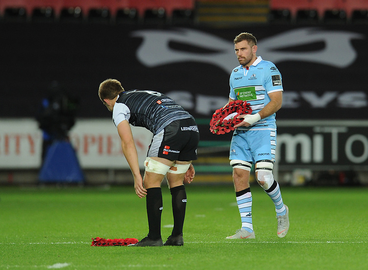 Glasgow Warriors' Callum Gibbins and Ospreys' Olly Cracknell lay wreathes before kick-off<br /> <br /> Photographer Kevin Barnes/CameraSport<br /> <br /> Guinness Pro14 Round 8 - Ospreys v Glasgow Warriors - Friday 2nd November 2018 - Liberty Stadium - Swansea<br /> <br /> World Copyright © 2018 CameraSport. All rights reserved. 43 Linden Ave. Countesthorpe. Leicester. England. LE8 5PG - Tel: +44 (0) 116 277 4147 - admin@camerasport.com - www.camerasport.com