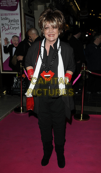 AMANDA BARRIE  .Press night for 'My Trip Down The Pink Carpet' at the Apollo Theatre, Shaftesbury Avenue, London, England..February 3rd 2011.full length black jeans denim top red jacket bracelets bag purse white scarf lips lego necklace .CAP/CAN.©Can Nguyen/Capital Pictures.