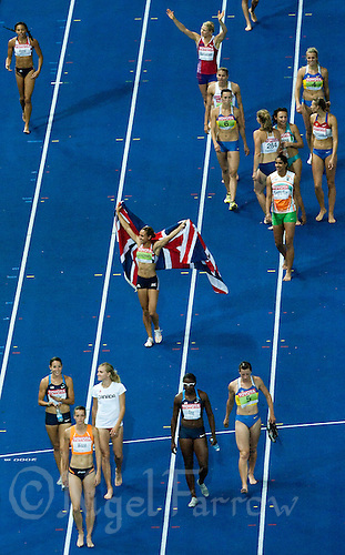 16 AUG 2009 - BERLIN, GER - Jessica Ennis (centre with flag) celebrates after winning the Heptathlon at the World Athletics Championships (PHOTO (C) NIGEL FARROW)