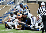 BROOKINGS, SD - DECEMBER 3:  Matt Gudzak #20 from Villanova is brought down by a host of defenders including Christian Banasiak #69 from South Dakota State on fourth down during their second round playoff game Saturday afternoon at Dana J. Dykhouse Stadium in Brookings, SD. (Photo by Dave Eggen/Inertia)
