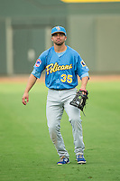 Kevin Brown (35) of the Myrtle Beach Pelicans warms up in the outfield prior to the game against the Winston-Salem Dash at BB&T Ballpark on August 20, 2015 in Winston-Salem, North Carolina.  The Dash defeated the Pelicans 5-4 on a walk-off wild pitch in the bottom of the 9th inning.  (Brian Westerholt/Four Seam Images)