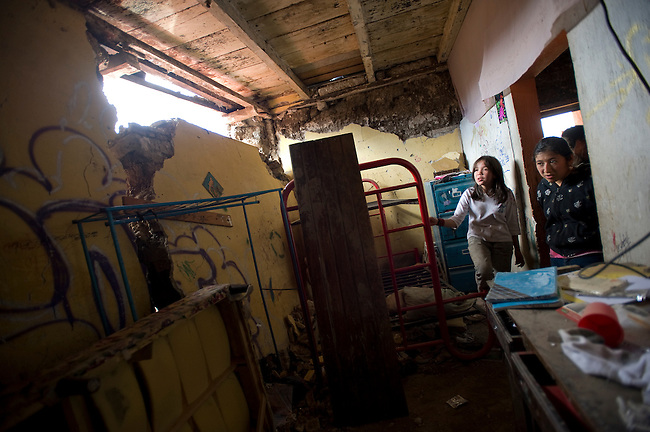 Mareela Serrano, 10, left, and Julissa Serrano,16, stand in their bedroom in San Marcos that was damaged after a 7.4 earthquake struck Guatemala.
