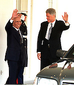 King Hussein of Jordan and United States President Bill Clinton wave as the President escorts the King to his car following their discussions at the White House on January 5, 1999..Credit: Ron Sachs / CNP