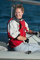 Catherine Corssen,'15, smiles at teammates during the Salve Regina Sailing Team practice in the Newport Harbor.