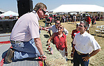 Nevada Reps., Mark Amodei, left, and Joe Heck, right, talk during the second annual Basque Fry in Gardnerville, Nev., on Saturday, Aug. 20, 2016. Heck's wife Lisa, and communications director Brian Baluta, are at center. More than 1,000 people attend the Republican rally and Basque-themed barbeque. Cathleen Allison/Las Vegas Review-Journal