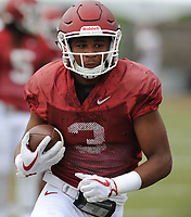 NWA Democrat-Gazette/ANDY SHUPE<br /> Arkansas receiver Koilan Jackson carries the ball Tuesday, Aug. 1, 2017, after making a catch during practice at the university's practice field in Fayetteville. Visit nwadg.com/photos to see more photographs from the day's practice.