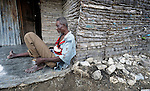 A man sits in front of his home in Batey Bombita, a community in the southwest of the Dominican Republic whose population is composed of Haitian immigrants and their descendents.