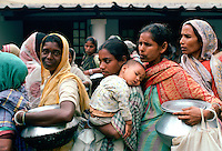 Poor women queuing for food at Mother Teresa's Mission in Calcutta,  India