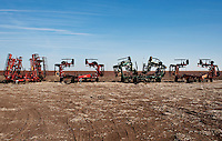 Old tractors owned by the Frische family next to their cotton field in Dumas, Texas, Tuesday, February 15, 2011. With the high price of cotton in recent years, many farmers in the area have switched to start farming cotton...Photo by Matt Nager