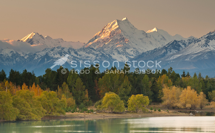 Sunset on Mount Cook and Mount Tasman from the eastern shores of Lake Pukaki in Fall.