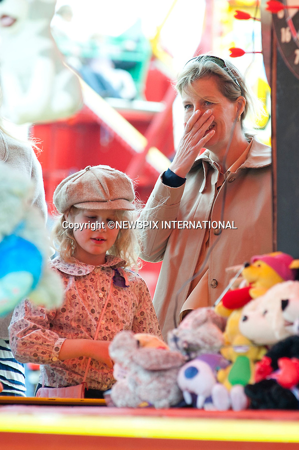 "Prince Edward, Sophie, The Countess of Wessex and their Lady Louise Windsor.enjoy a family day out at the Royal Windsor Horse Show the Wessex Family watched a show in the main arena after which Sophie and Lady Louise went and played on some of the fairground attractions including darts and hook a duck..It was all change from the pomp of the Royal Wedding two weeks ago for the young royal..The Royal Windsor Horse Show 2011, Windsor_14/05/2011.Mandatory Photo Credit: ©Dias/Newspix International..**ALL FEES PAYABLE TO: ""NEWSPIX INTERNATIONAL""**..PHOTO CREDIT MANDATORY!!: NEWSPIX INTERNATIONAL(Failure to credit will incur a surcharge of 100% of reproduction fees)..IMMEDIATE CONFIRMATION OF USAGE REQUIRED:.Newspix International, 31 Chinnery Hill, Bishop's Stortford, ENGLAND CM23 3PS.Tel:+441279 324672  ; Fax: +441279656877.Mobile:  0777568 1153.e-mail: info@newspixinternational.co.uk"