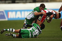 Manawatu's Mike Fitzgerald (top) and Aaron Smith tackle Josh Hall during the Air NZ Cup rugby match between Manawatu Turbos and Counties-Manukau Steelers at FMG Stadium, Palmerston North, New Zealand on Sunday, 2 August 2009. Photo: Dave Lintott / lintottphoto.co.nz