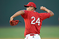 Starting pitcher Daniel Gonzalez (24) of the Greenville Drive delivers a pitch in a game against the Rome Braves on Saturday, August 12, 2017, at Fluor Field at the West End in Greenville, South Carolina. Rome won, 4-0. (Tom Priddy/Four Seam Images)