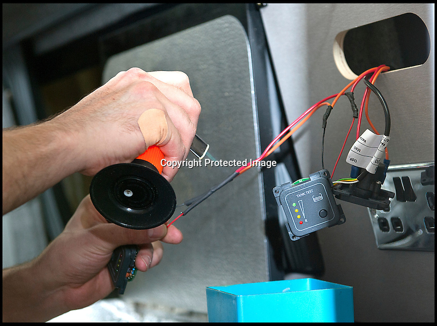 BNPS.co.uk (01202 558833)<br /> Pic: LauraJones/BNPS<br /> <br /> <br /> T5 fitter Kevin Harvey working on some wiring.<br /> <br /> The last ever delivery of brand new Volkswagen campervans has arrived in Britain marking the end of an era for the iconic 'hippy bus'.<br /> <br /> Ninety nine of the final batch of vans rolled off the production line and onto a container ship bound for British shores after manufacture ceased for good in Brazil in December.<br /> <br /> And though the consignment has only just arrived, almost all of the vans have already been snapped up by eager buyers happy to fork out the &pound;35,000 starting price.<br /> <br /> They are the last brand new campers in all of Europe.