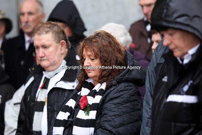 Swansea, UK. Sunday 09 November 2014<br /> Pictured: Swansea supporters observe a minute's silence after the plaque unveiling <br /> Re: Swansea City FC have unveiled a plaque for three former players who died during the First World War commemorating this way Remembrance Sunday. It was unveiled before the Barclays Premier League, Swansea City FC v Arsenal City at the Liberty Stadium, south Wales, UK