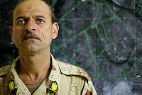 Iraqi tanker company  Sergeant Major Ali Hassan from the 1st company, 1st armour battalion of the 1st mechanized Iraqi Army Brigade stands at his operation center   while conducting  patrols, check points and observation posts on code name route Michigan, the main road of Ramadi in the week during the national election on TUE Dec 13 2005 in Ramadi, Iraq. 1st company is part of the first armor battalion of the New Iraqi Army. it has started its training in January 2005. after 50 days their 35 russian and chinese built T 55 tanks begun conducting operations under the guidance of a US military adivisor team. in April 2005 they patrolled in the Abu Ghraib area concluding their first significant mission. While these old tanks are rolling on the ramadi streets more modern T72s are getting ready to become fully operational in Taji, their main base. the Iraqi army wanted to show their power in ramadi during the Dec 15 elections displaying their new armour company. but like all the other Iraqi forces they are not going to secure the polling sites, staying in the rear with the rest of the iraqi and coalition forces. T 55s are very old tanks. production begun in the late 50s to the late 70s. athough obsolete many countries still use the T55 as their main heavy armoured combat vehicle. slow, heavvy and with very little room for the crew it suffers from many mechanical problems constantly challenging the iraqi mechanics and engineers.