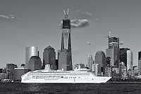 PO Cruises cruise ship Aurora heads south on the Hudson River past the rising Freedom Tower and the lower Manhattan skyline