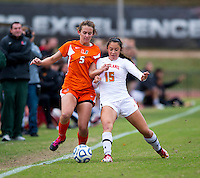 Erika Nelson (15) of Maryland fights for the ball with Ashley Flinn (5) of Miami during the game at Ludwig Field in College Park, MD.  Maryland defeated Miami, 2-1, in overtime.