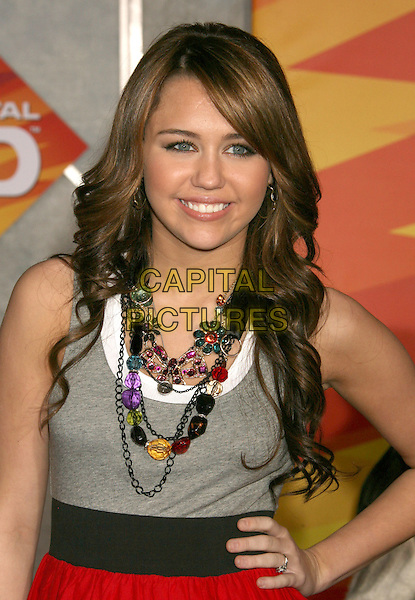 "MILEY CYRUS.""Bolt"" Disney World Premiere held at the El Capitan Theatre, Hollywood, California, USA..November 17th, 2008.half length grey gray top necklaces hand on hip .CAP/ADM/MJ.©Michael Jade/AdMedia/Capital Pictures."