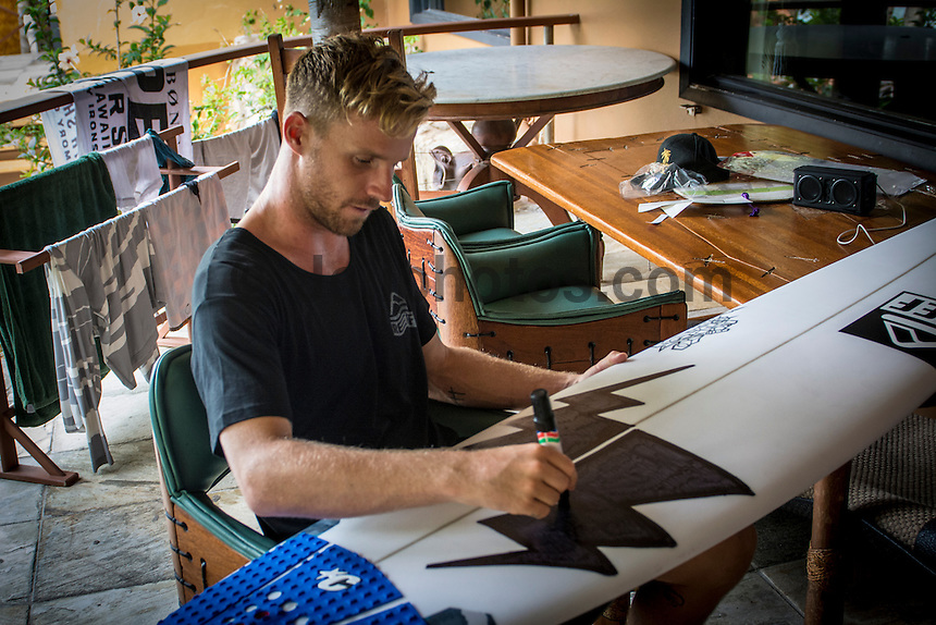 Namotu Island Resort, Namotu, Fiji. (Saturday May 31, 2014) Mitch Crews (AUS) getting his surfboards all stickered up after signing with Reef. –  The official Opening Ceremony for the 2014 Fiji Pro was held this afternoon on Tavarua Island with a tradition blessing and kava ceremony for the officials and Top 34 surfers. Photo: joliphotos.com