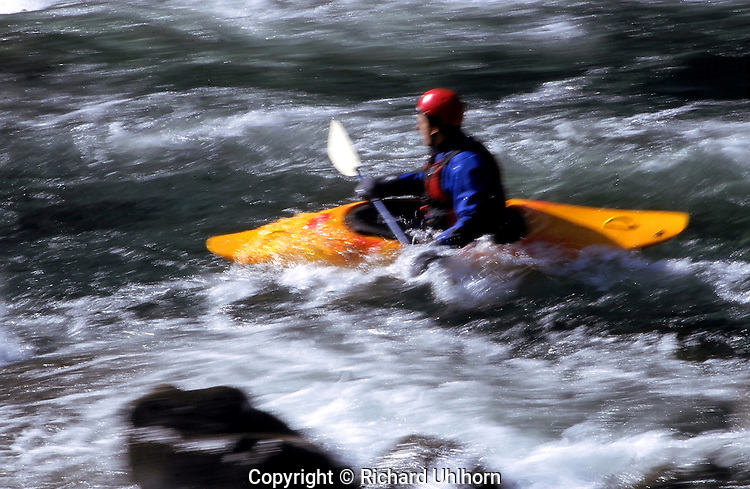 A kayaker runs Tumwater Canyon on the Wenatchee River outside of Leavenworth, Washington.