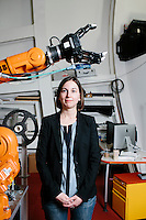 "Julie Shah is an Assistant Professor in the Department of Aeronautics and Astronautics and leads the Interactive Robotics Group in MIT's Computer Science and Artificial Intelligence Laboratory in Cambridge, Massachusetts, USA. She is seen here with an ABB industrial robot. Shah uses these robots in research on ""elbow to elbow"" manufacturing, in which humans and robots work side by side in the same area."