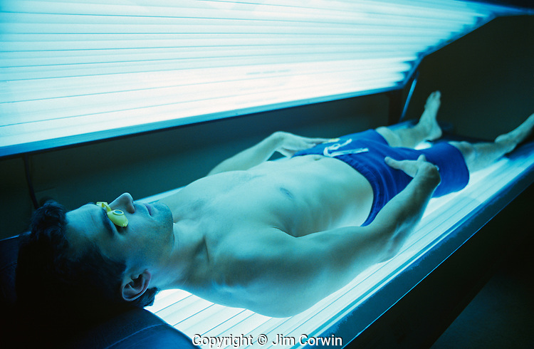 Young man in tanning bed