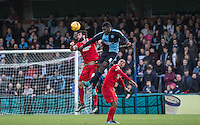 Aaron Pierre of Wycombe Wanderers beats Ollie Palmer of Leyton Orient to the ball as Jay Simpson of Leyton Orient looks on during the Sky Bet League 2 match between Wycombe Wanderers and Leyton Orient at Adams Park, High Wycombe, England on 23 January 2016. Photo by Andy Rowland / PRiME Media Images.