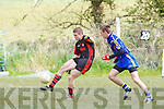 Kenmare's Stephen O'Brien and Ballymac's Matthew Galvin in action in the junior county championship quarter final at Ballymac on Sunday.