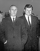 "Camp Springs, MD - (FILE) -- United States Senate Majority Leader Mike Mansfield (Democrat of Montana), left, and Senate Majority Whip Edward M. ""Ted"" Kennedy, right, stand unprotected from the rain as they await the arrival of U.S. President Richard M. Nixon (not pictured), who was leaving for his first trip to Europe as President at Andrews Air Force Base in Camp Springs, Maryland on February 23, 1969..Credit: Arnie Sachs / CNP"