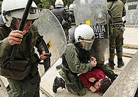 Pictured: Riot police clash with protesters by the statue of Harry S. Truman in Vassileos Georgiou Street in central Athens, Greece. Monday 16 April 2018<br /> Re: Clashes broke out between protesters and the police when members of the Greek Communist Party (KKE) attempted to vandalise the statue of former US President Harry S. Truman, during a protest against the bombing of Syria by the US and its allies.