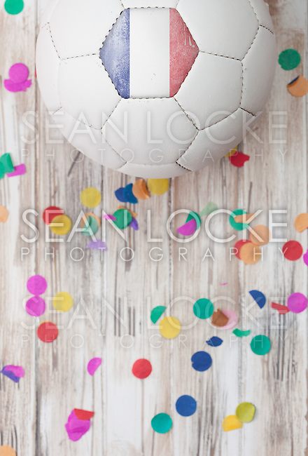 Series of a soccer ball with an international flag on a confetti background.