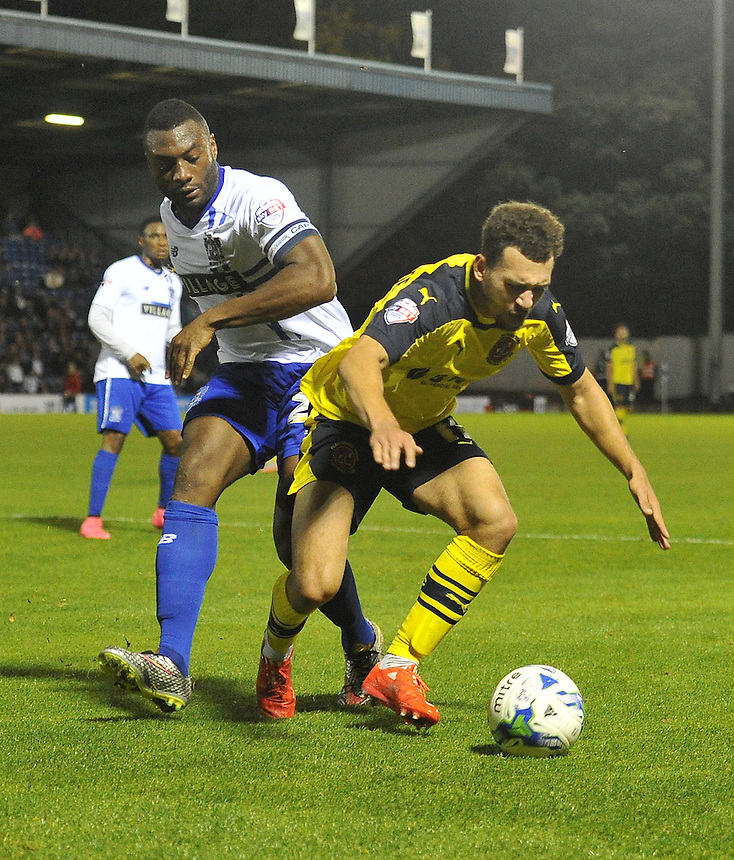 Fleetwood Town's Lyle Della Verde is brought down in the penalty area by Bury's Nathan Cameron<br /> <br /> Photographer Dave Howarth/CameraSport<br /> <br /> Football - The Football League Sky Bet League One - Bury v Fleetwood Town - Tuesday 18th August 2015 - Gigg Lane - Bury<br /> <br /> &copy; CameraSport - 43 Linden Ave. Countesthorpe. Leicester. England. LE8 5PG - Tel: +44 (0) 116 277 4147 - admin@camerasport.com - www.camerasport.com