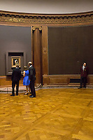 NEW YORK - OCT 21: Members of The Frick Collection view the Vermeer painting Girl WIth The Pearl Earring during a private opening of the exhibtion: Vermeer, Rembrandt, and Hals: Masterpieces of Dutch Painting from the Mauritshuis on Monday, October 21, 2013 in New York City. (Photo by Landon Nordeman)